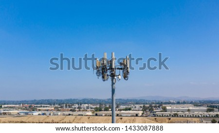 Aerial view of cell tower antennas for wireless 3G, 4G or 5G mobile phone networks and telecom internet communication