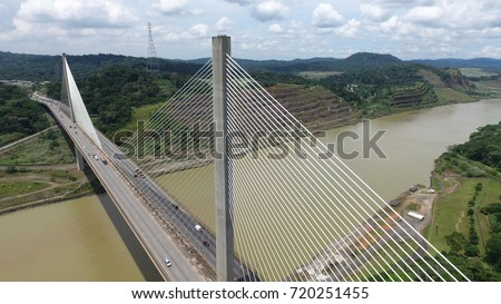 Aerial view of Centennial Bridge across the Panama Canal looking towards the South side of Panama #720251455