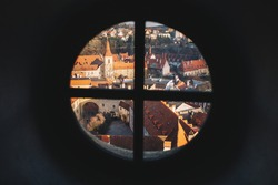 Aerial view of Cesky Krumlov red roofs in winter from observation point