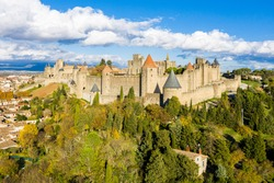 Aerial view of Cité de Carcassonne, a medieval hill-top citadel in the French city of Carcassonne, Aude, Occitanie, France. Founded in the Gallo-Roman period, the town is fortified by two castle walls