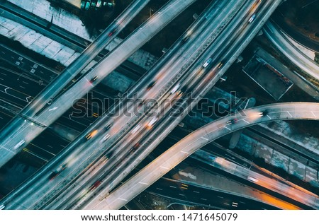 Aerial view of city landscape with autobahn motorway in metropolis, Bird's eye evening view. automobiles moving at street with modern automotive expressway. interchange road highway, junctions freeway Stock photo ©