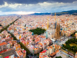 Aerial view of cityscape of Barcelona, Eixample district and Sagrada Familia