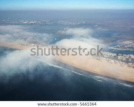 Aerial view of clouds covering beachfront in Southern California.