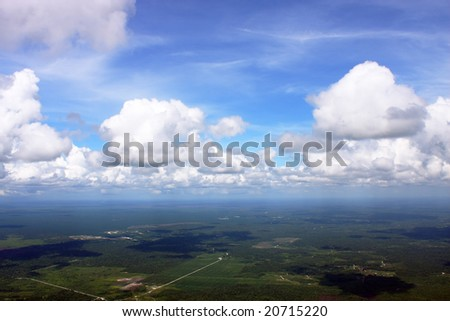 Aerial view of cloudspace over greeny land.