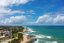Aerial View of Coastal Lighhouse in the Paradisiac Beach. Great Landscape. Tropical Scenic. Paradisiac Beach. Scenic Landscape. Tourism Scenic. Outdoor Scenic. Lighthouse in Beach. Beauty Coast Beach.