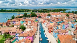 Aerial view of colorful Burano island in Venetian lagoon sea from above, Italy