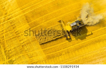 Aerial view of combine harvester on rapeseed field. Agriculture and biofuel production theme. - Shutterstock ID 1108291934