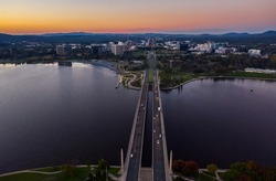 Aerial view of Commonwealth Bridge on Lake Burley Griffin during a beautiful sunset in Canberra, Australia