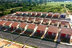 Aerial view of community houses in construction. Panoramic view of popular housing. Great landscape. Popular houses. Community housing. Construction landscape. Popular neightborhood houses.