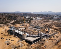 Aerial view of construction crews building new stadium arena in San Diego. High quality photo