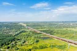 Aerial view of construction of road bridge on motorway in countryside