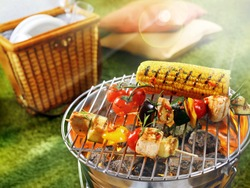 Aerial view of corn cob and vegetarian barbecue on a grilling pan