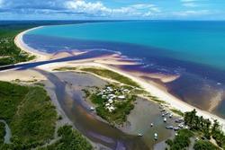 Aerial view of Corumbau beach, Caraíva, Bahia, Brazil. Great landscape. Beatiful beach with two colors of water. Beautiful beach scene. Vacation, travel, resort, peace, tranquility, paradisiac.