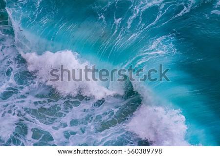 Aerial view of crashing waves #560389798