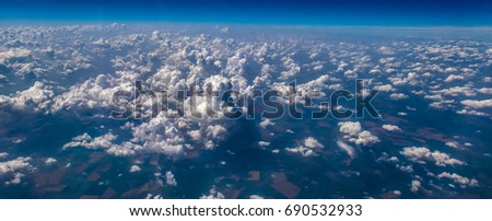 Aerial view of curly sunny cloudscape and their shadows  #690532933
