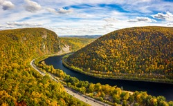Aerial view of Delaware Water Gap on a sunny autumn day with forward camera motion. The Delaware Water Gap is a water gap on the border of the U.S. states of New Jersey and Pennsylvania
