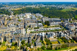 Aerial view of Dinan commune with modern and medieval buildings, Brittany, northwestern France