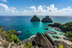 Aerial view of Dois Irmaos Hill from Baia dos Porcos beach, with turquoise clear water, at Fernando de Noronha Marine National Park, a Unesco World Heritage site, Pernambuco, Brazil, July 2019