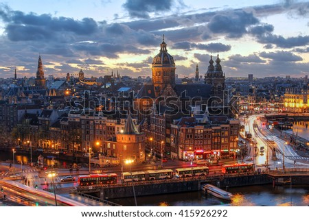 Aerial view of downtown Amsterdam, The Netherlands during a dramatic beautiful sunset.