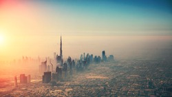 Aerial view of Dubai city in sunset light. Panoramic view. Dubai is the biggest and most modern city in UAE.
