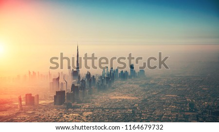 Aerial view of Dubai city in sunset light. Panoramic view. Dubai is the biggest and most modern city in UAE. #1164679732