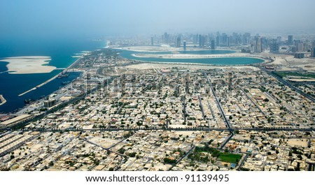Aerial view of Dubai city with apartments and skyscraper (United Arab Emirates) - stock photo