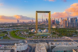 Aerial view of Dubai Frame, Downtown skyline, United Arab Emirates or UAE. Financial district and business area in smart urban city. Skyscraper and high-rise buildings at sunset.