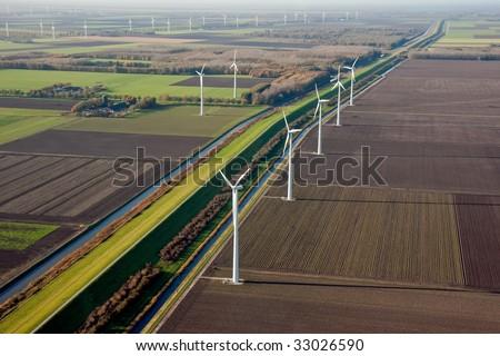 Aerial view of Dutch farmland with  windmills