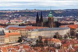 Aerial view of e of Prague Castle and Metropolitan Cathedral of Saints Vitus with historic buildings from Petrin Hill on the day with Czech Republic