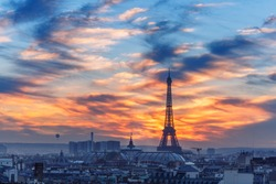 Aerial view of Eiffel tower and the rooftops of Paris during a gorgeous sunset, France