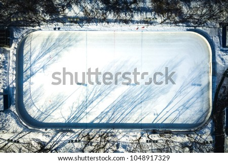 aerial view of empty hockey skate rink on a winter sunny day #1048917329