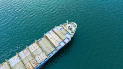Aerial view of empty international containers cargo ship at industrial import-export port transport goods around world, global transportation and logistic business.Oversea international Business.