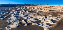 Aerial view of eroded landscape of pumice stone fields nearby El Peñón village in La Puna highlands ecoregion of the Andes in Argentina, South America, America