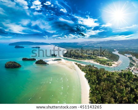 Aerial view of estuary, river, beach and islands with deep blue sky and strong sunshine.