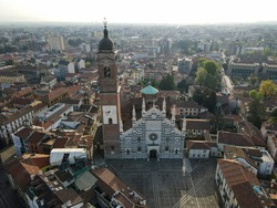 Aerial view of facade of the ancient Duomo in Monza (Monza Cathedral). Drone photography of the main square with church in Monza in north Italy, Brianza, Lombardia.