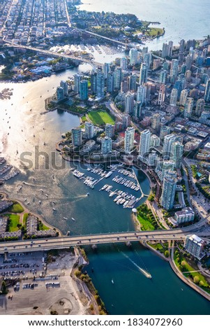 Aerial view of False Creek in Downtown Vancouver, British Columbia, Canada. Modern City viewed from above. Bright Sunny Day
