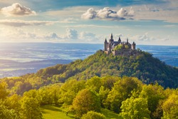 Aerial view of famous Hohenzollern Castle, ancestral seat of the imperial House of Hohenzollern and one of Europe's most visited castles, in beautiful golden evening light, Baden-Wurttemberg, Germany