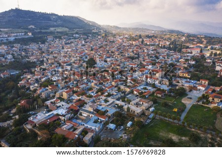 Aerial view of famous landmark valley Pano Lefkara village, Larnaca, Cyprus with orange ceramic roofs, drone photo. #1576969828