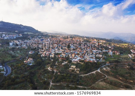 Aerial view of famous landmark valley Pano Lefkara village, Larnaca, Cyprus with orange ceramic roofs, drone photo. #1576969834