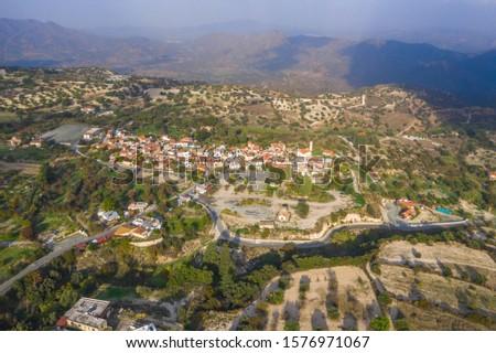 Aerial view of famous landmark valley Pano Lefkara village, Larnaca, Cyprus with orange ceramic roofs, drone photo. #1576971067