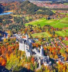 Aerial view of famous Neuschwanstein Castle in autumn. Location: village of Hohenschwangau, near Füssen, southwest Bavaria, Germany, Europe