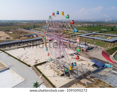 Aerial view of ferris wheel in empty amusement park during off season, China, Zhangjiakou.