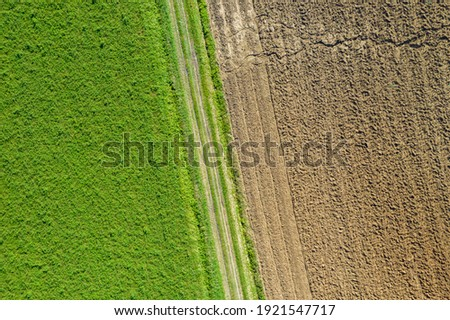 Aerial view of fertile and dry arid terrain. Grooves in the fields seen from above. Climate change concept, arid land, desertification. Copy space, texture, background Photo stock ©
