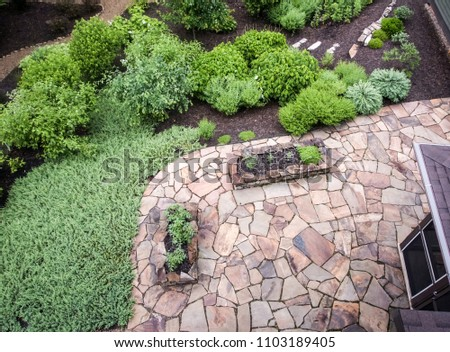 Aerial view of flagstone patio and garden