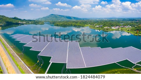Photo of  Aerial view of Floating solar panels or solar cell Platform system on the lake
