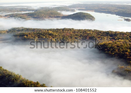 Aerial view of fog in autumn over islands and hills north of Portland, Maine