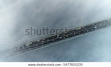 Photo of  Aerial view of foggy  Istanbul Bosphorus Bridge. 4K Drone Footage in Turkey.
