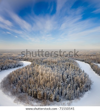 Aerial view of forest river in time of winter day.