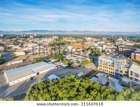 aerial view of Fort Collins downtown with Front Range of Rocky Mountains on horizon, late summer Photo stock ©