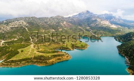 Aerial view of Gecitkoy dam(Geçitköy Barajı) with turquoise water in Kyrenia, Northern Cyprus. Clouds are reflected in the dam. Geçitköy Dam in North Cyprus